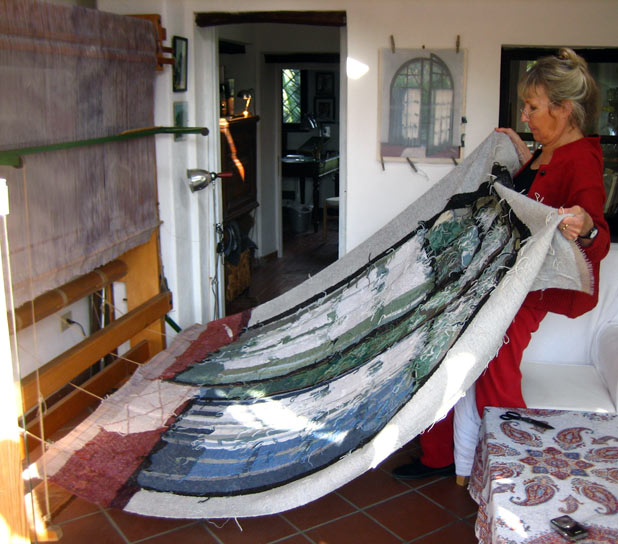 Removing the tapestry from the loom