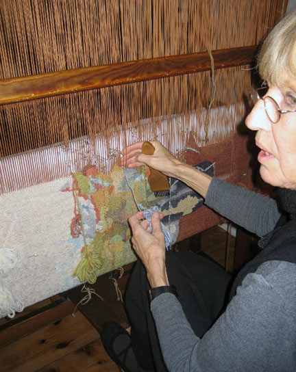 Weaving with the small balls of wool